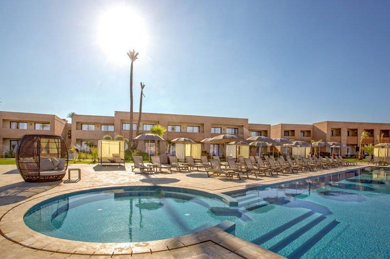 Sun loungers at swimming pool