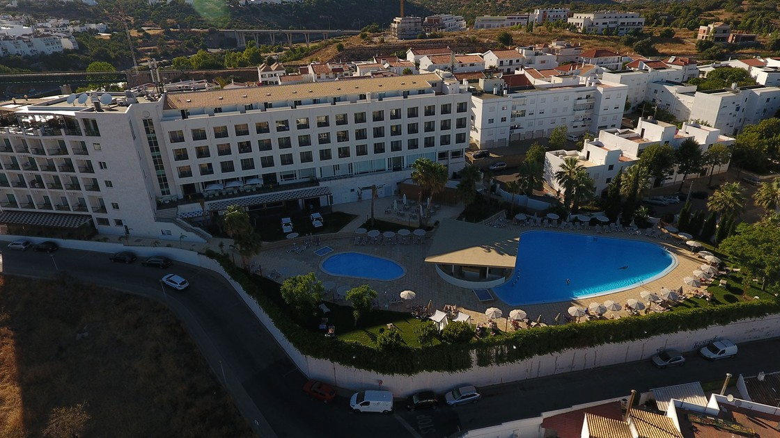 Overhead photo of hotel and pool