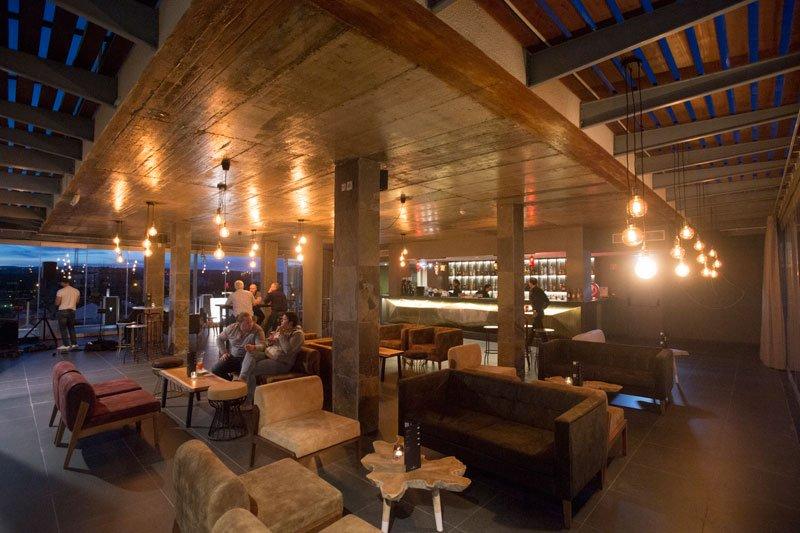 Photo of the Nomad Bar at night at Maria Nova Lounge Hotel